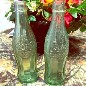 2 vintage coke collection bottles. 1938 and 1950